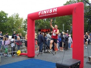 Leslie's brother Andrew leaping across the finish line