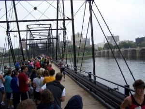 Runners crossing the bridge to the finish line